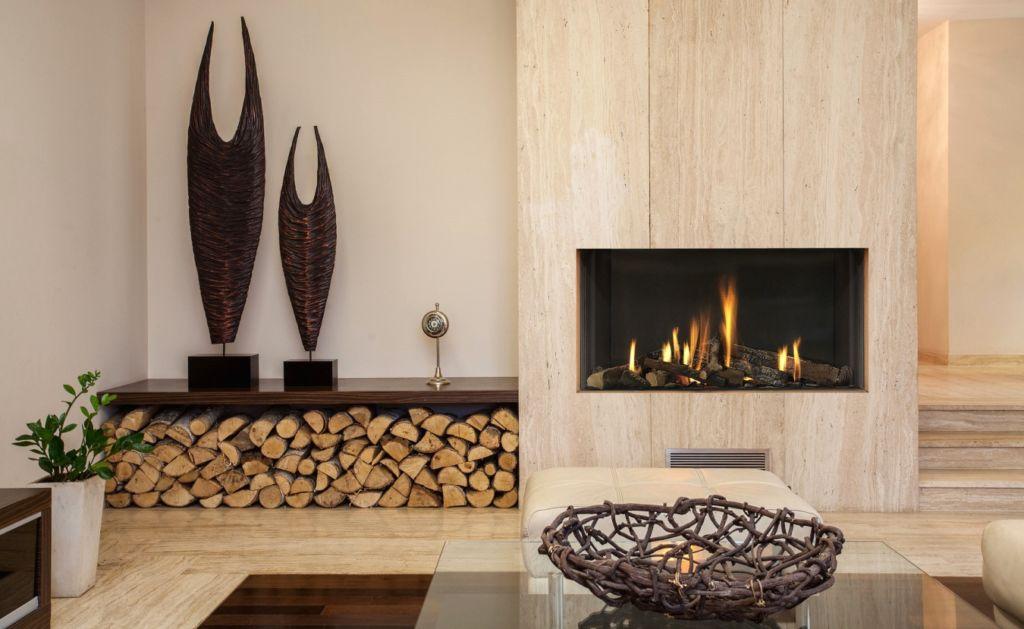 Камин - это сложная система дымохода, с внутренней конструкцией, которая обеспечивает обогрев помещения