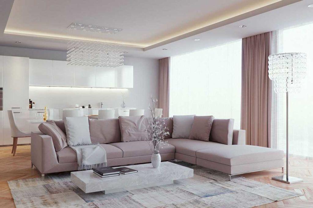 Чем светлее потолок, тем выше и просторнее кажется гостиная, что для интерьера в сером цвете немаловажно