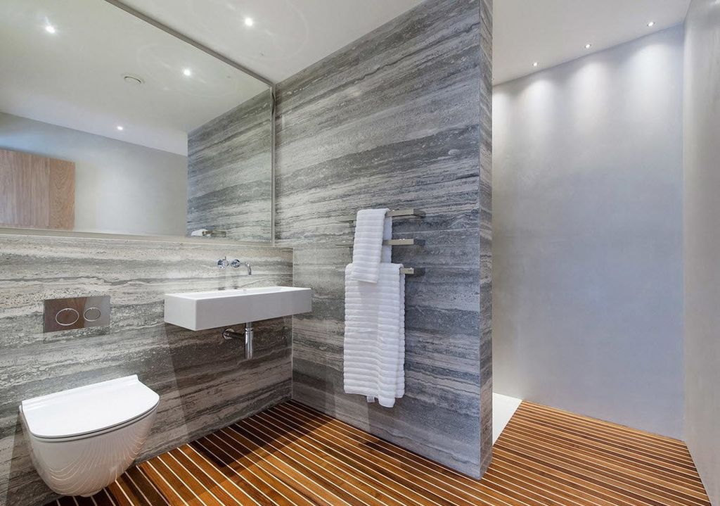 В стилистике лофт и минимализм можно использовать варианты поддона со стеклянной дверью