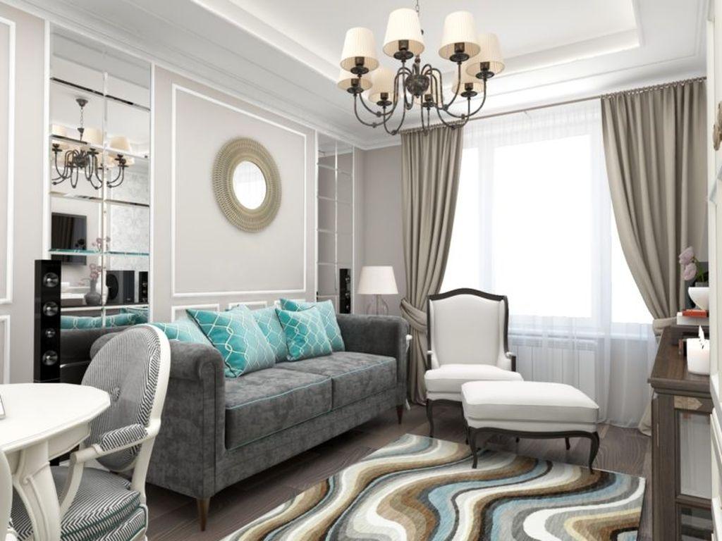 Рисунок ковра сочетается с подушками на диване