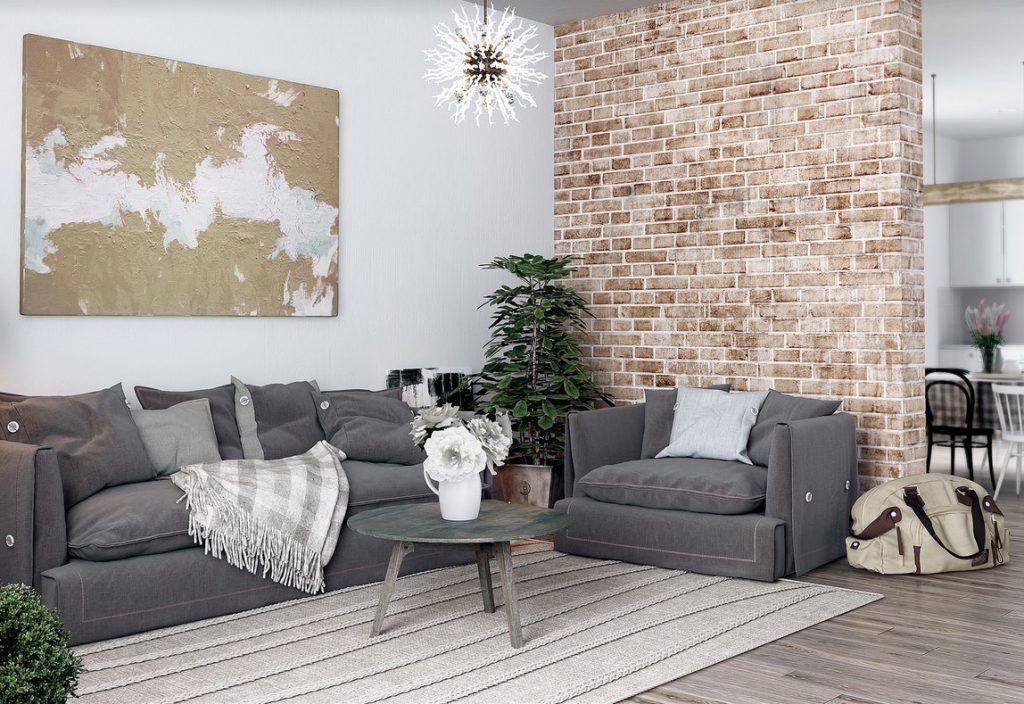 С подушками и одеялами серый диван хорошо смотрится в стиле кантри