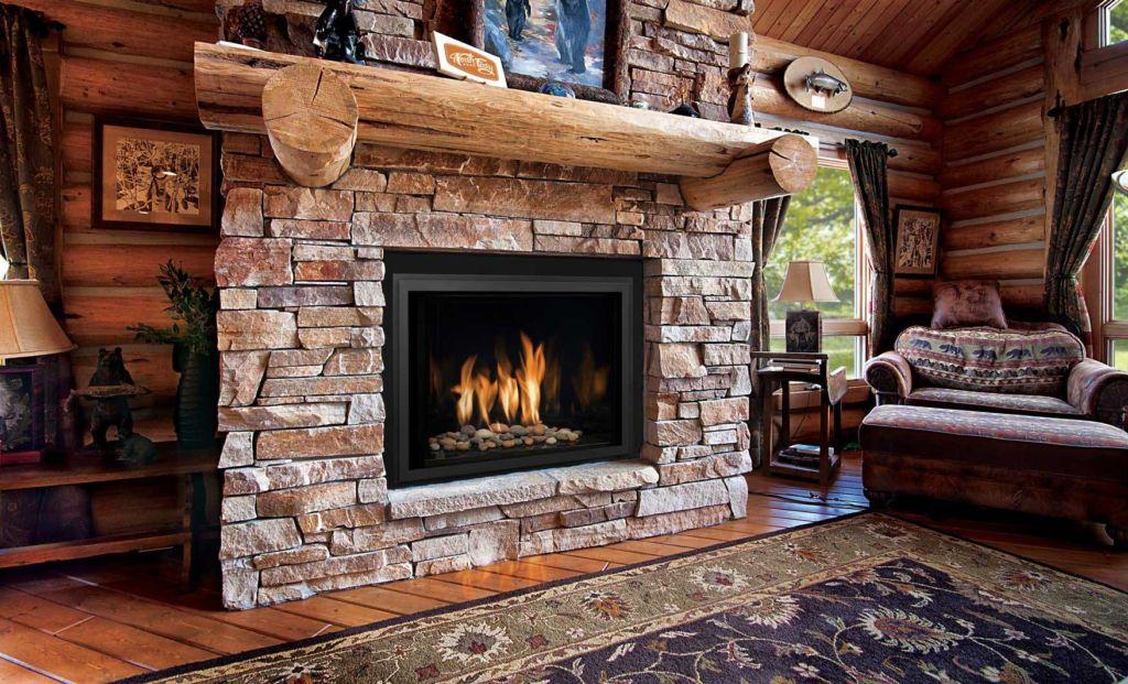 После завершения установки дымохода, можно приступать к облицовке стен камина керамогранитом или искусственным камнем