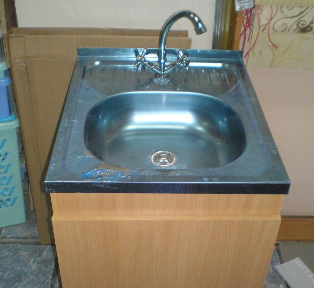 Для завершения установки соедините сифон с канализационной трубой